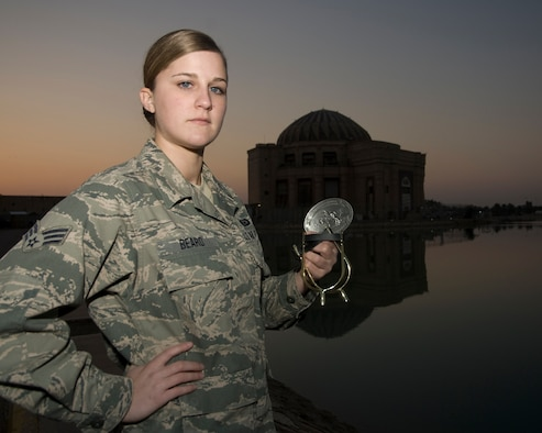 Senior Airman Courtney Beard with her spurs and III Corps belt buckle Jan. 16, 2010, on Camp Slayer, Iraq. Airman Beard was the first female Airman to complete the 18-hour Spur Ride, a series of mental and physical tests, held by the III Corps, Task Force Phantom. Airman Beard is a 467th Expeditionary Intelligence Squadron intelligence analyst. (U.S. Air Force photo by Staff Sgt. R. Michael Longoria)