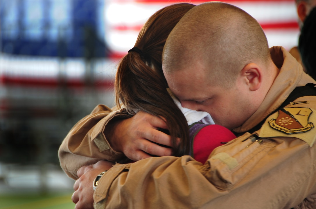 Capt. Allen Ferkovich, 37th Bomb Squadron weapon systems officer instructor from Ellsworth Air Force Base, S.D., shares one last hug with his wife before leaving for Southwest Asia, Jan. 15, 2011.  Approximately 300 Airmen deployed in support of overseas contingency operations. (U.S. Air Force photo/Senior Airman Anthony Sanchelli)