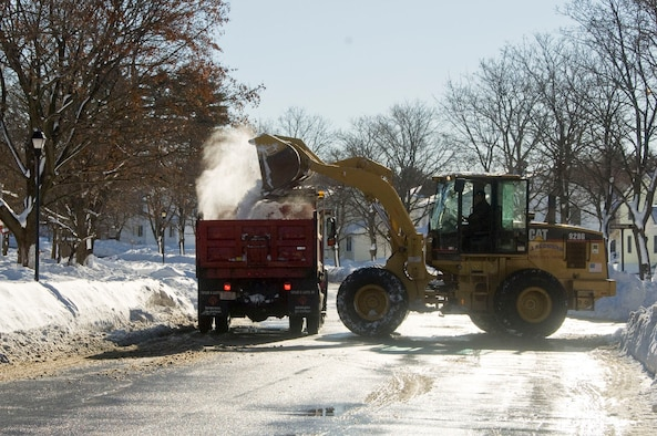 HANSCOM AIR FORCE BASE, Mass. – Snow is dumped into a dump truck in the housing area on Jan. 13. The base closed for two days after more than a foot of snow fell on Jan. 12. This was the second major snowstorm of the season. (U.S. Air Force photo by Mark Herlihy)