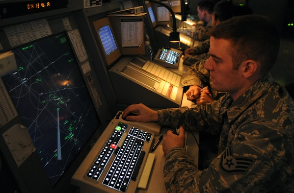 JOINT BASE BALAD, Iraq- - Staff Sgt. Steven Ott, 332nd Expeditionary Operations Support Squadron air traffic control journeyman, checks airspace activity while directing pilots toward specific coordinates. Sergeant Ott is a native of Poulsbo, Wash., and is deployed from Spangdahlem Air Base, Germany.  (U.S. Air Force photo/ Staff Sgt. Keyonna Fennell)