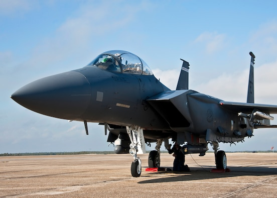 Steve Coleman, F-15E crew chief, completes last minute checks underneath the plane prior to it taxiing out from Eglin Air Force Base's flightline, Jan. 18.  The Strike Eagle flew the first ever sortie with the new APG-82 radar.  The new radar replaces the 24-year-old APG-70 radar system.  (U.S. Air Force photo/Samuel King Jr.)