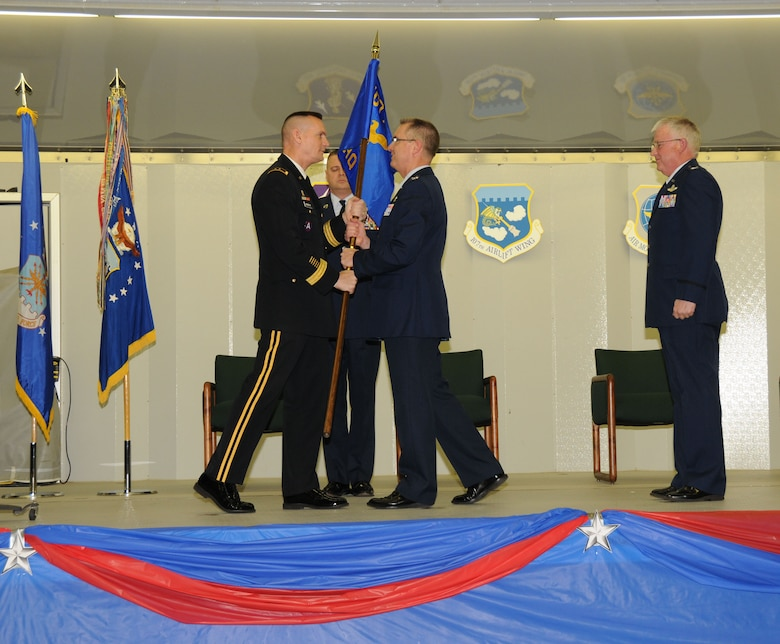 """On Jan 22nd in a ceremony attended by more than 1,000 military members, family, and friends, Colonel Jim McCready assumed command of the 107th Airlift Wing. New York State Adjutant General, Maj. Gen. Patrick Murphy (on left) passes the Wing's colors to the new commander as the outgoing 107th AW Commander (on right) Col. Patrick Ginavan looks on. Well suited for the new challenge, Col. McCready previously served as the wing's vice commander, responsible for equipping and training the wing?s 800 Airmen. """"I'm honored to be the next wing commander of the 107th, it?s a great challenge, we have a great wing with incredibly talented individuals and I look forward to leading them into the next chapter for the wing,"""" said Col McCready. (U.S. Air Force photo/Senior Master Sgt. Ray Lloyd)"""