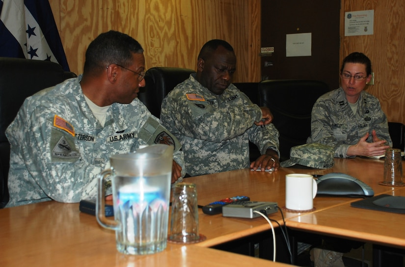 SOTO CANO AIR BASE, Honduras -  Brig. Gen. LaWarren V. Patterson (left), Commanding General of the 7th Signal Command out of Fort Gordon, Ga., ponders an information systems protection question from Joint Task Force-Bravo Director of Communications Capt. Kelly West (right) here, 21 Jan.  General Patterson manages all Army network operations in the Western Hemisphere.  He and his leadership team we're here to immerse themselves in the JTF-B mission to identify how better they could better assist/support current information technology requirements. (U.S. Air Force photo/Capt. John T. Stamm)