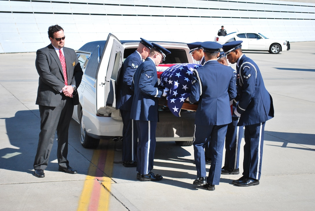 Airmen from the Eglin Air Force Base, Fla., Honor Guard place the coffin of 1st Lt. Robert Franklin Dees in to a waiting hearse Jan. 21, 2011, at Pensacola Regional Airport, Fla. Lieutenant Dees was missing since the Korean War and was being returned home to Ozark, Ala., for burial. (U.S. Air Force photo/Van Williams)