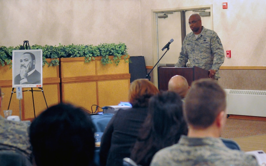 "Chief Master Sgt. Jerry Moore speaks at the Martin Luther King Day Breakfast Jan. 20, 2011, Eielson Air Force Base, Alaska. Chief Moore's speech gave little known facts about Martin Luther King in the form of ""Did you know..."" Command Chief Moore is the 354th Fighter Wing Command Chief. (U.S. Air Force Photo by/ Airman 1st Class Janine Thibault)"
