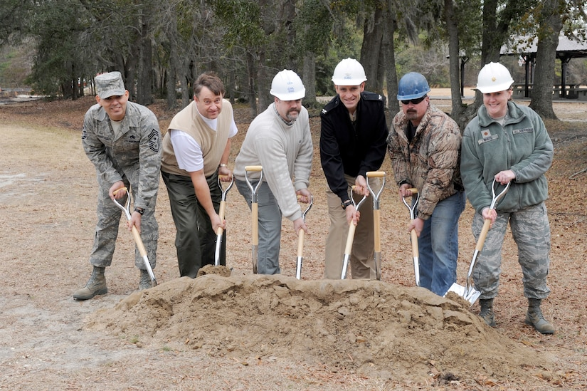 left to right: U.S. Air Force Chief Master Sgt. Jose LugoSantiago, Mr. Robert Hood, Mr. Todd Martin, U. S. Navy Capt. Ralph Ward, Mr. Rob Farcloth and Maj. Tara White prepare to break ground during the ground breaking ceremony for the Outdoor Recreation Center family campground Jan 26, 2011 at Joint Base Charleston-Air Base. This ground breaking is an upgrade to a community facility that will be able to accommodate 45 recreational vehicles and campers as opposed to the current campground that can only accommodate 17 RV's and campers. Chief LugoSantiago is the 628th Air Base Wing command chief, Mr. Hood is assigned to the 628th Contracting Squadron as the chief of construction flight, Mr. Martin is assigned to the 628th Civil Engineer Squadron, Captain Ward is the Joint Base Charleston deputy commander, Mr. Farcloth is a contractor with Lake Moultrie Construction and Major White is the 628th Force Support Squadron commander. (U.S. Air Force photo/Staff Sgt. Marie Brown)