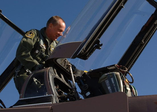 Gen.  Donald Hoffman, Air Force Materiel Command commander, climbs into a QF-4 Phantom II during his visit to Holloman Air Force Base, N.M., Jan. 21, 2011. The QF-4 is modified from a baseline F-4 aircraft and can be flown remotely by a ground controller or by a pilot in the cockpit.  (U.S. Air Force photo/Senior Airman Michael Means)