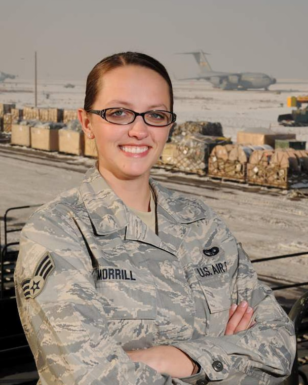 Senior Airman Kathryn Morrill of the small air terminal at the 133rd Logistics Readiness Squadron pauses near the flightline of a deployed location in November 2010 where she was working loading aircraft in support of Operation Enduring Freedom and Operation New Dawn. Morrill has been selected to represent Minnesota as the Air Guard Outstanding Airman for 2011.