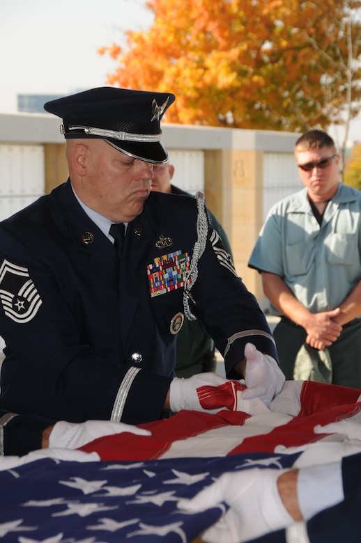 Senior Master Sgt. Dave Gonsoski, superintendant of the power production shop at the 133rd Civil Engineer Squadron, folds a flag over the remains of a fallen Airman during a funeral at the Fort Snelling Cemetery in Minneapolis, Minn. on Oct 12, 2010. Gonsoski has been selected to represent Minnesota as the Air Guard Outstanding Honor Guard member for 2011. USAF official photo by Senior Master Sgt. Mark Moss