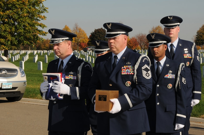 Senior Master Sgt. Dave Gonsoski (center) holds an urn with the ashes of a fallen Airman as the 133rd Airlift Wing Base Honor Guard marches in a funeral procession at Fort Snelling National Cemetery on Oct. 12, 2010. Gonsoski has been selected to represent Minnesota as the Air Guard Outstanding Honor Guard member for 2011.USAF official photo by Senior Master Sgt. Mark Moss