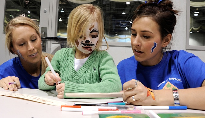 Cadet 3rd Class Layne Harrod, left, and Cadet 2nd Class Chelsaa Ragland, right, help Oakley Gardner build a balsa glider during a Leaders in Flight Today program outing at the Cadet Field House Jan. 22, 2011. Oakley is the daughter of Army Staff Sgt. Erich Gardner, who is stationed at Fort Carson, Colo. (U.S. Air Force photo/Mike Kaplan)