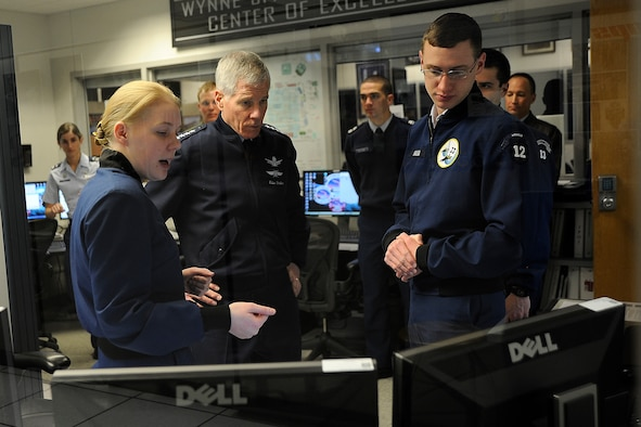 Cadet 1st Class Kathryn Blythe (left) and Cadet  2nd Class Chris Hassa (right) explain FaclonSAT-5 operations to Gen. William Shelton during his visit to the Academy's Department of Astronautics Jan. 24, 2011. General Shelton, the commander of Air Force Space Command and a 1976 Academy graduate who majored in astronautical engineering, received briefings on the FalconSAT and FalconLAUNCH programs at the Academy. Cadet Blythe is the FalconSAT-5 program manager, and Cadet Hassa is a FalconSAT-5 satellite operator. (U.S. Air Force photo/Rachel Boettcher)