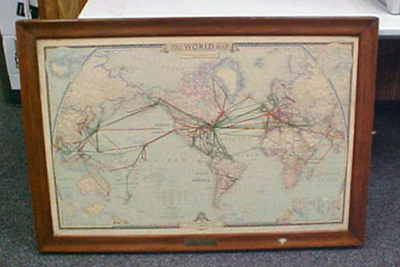 The front of this map case has a world map on it, and the inside cover includes multiple paper maps covering the entirety of the globe in labeled manila pockets. The inside of the case includes 18 rolled maps of various world regions. The map case was presented to Gen. Thomas D. White by the National Geographic Society. Gen. White served as Chief of Staff of the United States Air Force from 1957-1961. (U.S. Air Force photo)