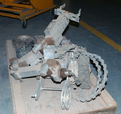 This robot, controlled by an Air Force Explosive Ordnance Disposal (EOD) team, was destroyed by an improvised explosive device during Operation Iraqi Freedom. (U.S. Air Force photo)