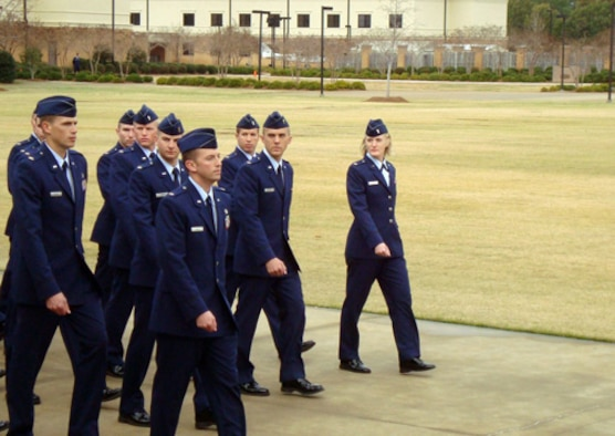 (Far right) Second Lieutenant Melanie Singer marches in the ceremonial parade during her graduation from Officer Training School at Maxwell Air Force Base, Ala., on Dec. 16. (U.S. Air Force photo/Chief Master Sgt. David Macerelli)