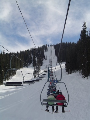 A full three-person Legends chair lift carries skiers and snowboarders alike to the top of the farthest peak from the base at Purgatory at Durango Mountain Resort, Durango, Colo. The lift passes over Blackburn Bash, a single black diamond and most difficult trail, before dropping its passengers off at intermediate, most difficult and expert trails. (Photo by Brandice J. O'Brien)