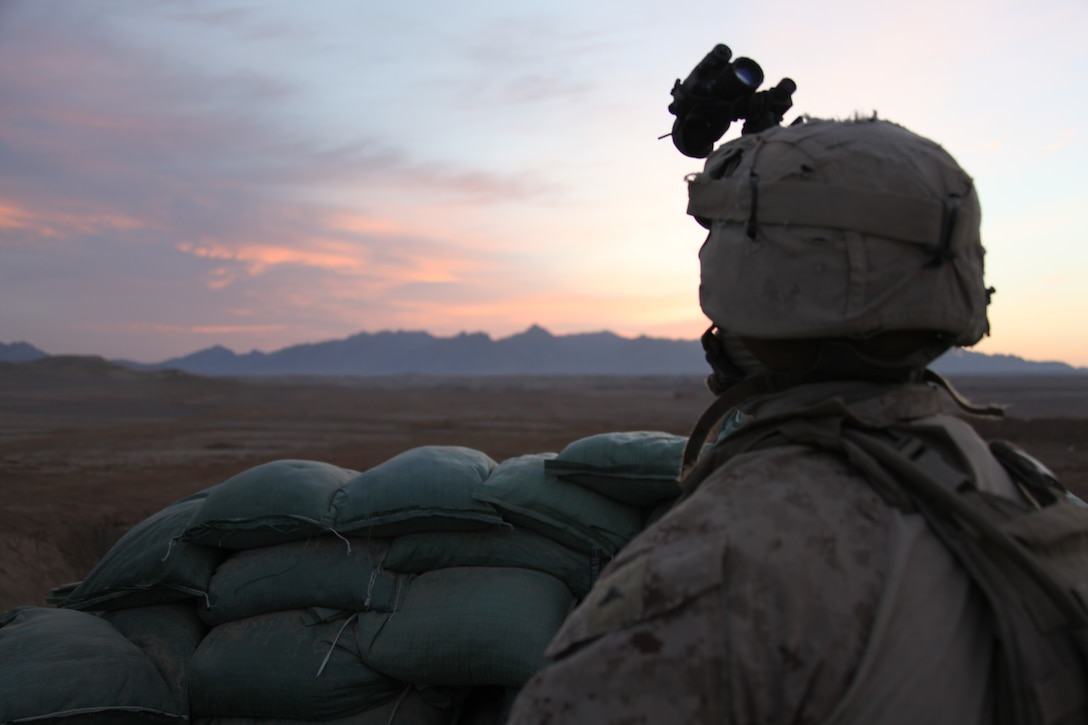 U.S. Marine Corps Lance Corporal Antonio Wilcoxson, a rifleman with 1st Platoon, Company I, Battalion Landing Team 3/8, 26th Marine Expeditionary Unit, Regimental Combat Team 2, stands post as the sun rises at a patrol base near Combat Outpost Ouellette, Helmand province, Afghanistan, Jan. 31, 2011. Elements of 26th Marine Expeditionary Unit deployed to Afghanistan to provide regional security in Helmand province in support of the International Security Assistance Force.