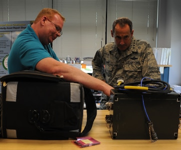 Steven Compton explains maintenance procedures to Gen. Raymond E. Johns Jr. during a tour of the Priority Asset Repair Section at Joint Base Charleston- Air Base June 29. Johns toured JB CHS- AB and Weapons Station during his two day visit. Johns is the Air Mobility Command commander and Compton is with the 437th Aircraft Maintenance Squadron. (U.S. Air Force photo/ Staff Sgt. Nicole Mickle)