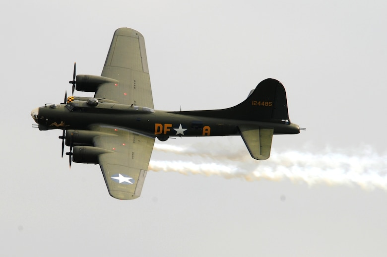 "ROYAL AIR FORCE FELTWELL, England -- The B-17 Flying Fortress ""Sally B"" performs a flyover during the Fourth of July celebration, July 4, 2011.  Airmen, their families and local community members came together to enjoy a carnival filled with food, games, rides, aerial displays and fireworks. (U.S. Air Force photo/Staff Sgt. Connor Estes)"