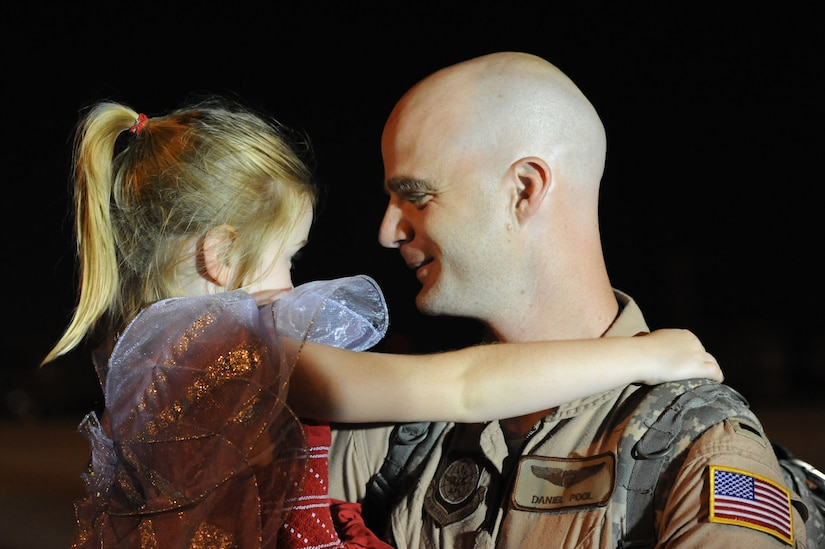 1st Lt. Grant Daniel Pool greets his daughter Nadia on the flightline July 1 at Joint Base Charleston -  Air Base, S.C.  Lieutenant Pool was one of more than 120 Airmen from the 17th Airlift Squadron returning home after a four-month deployment to the Middle East. While deployed, the Airmen flew roughly 2, 850 sorties and airlifted more than 107 million pounds of cargo through out the area of responsibility.  (U.S. Air Force photo Staff Sgt. Nicole Mickle)