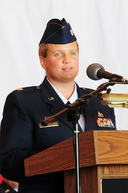 Lt. Col. Kelley C. Stevens accepts command of the 552nd Aircraft Maintenance Squadron in an official ceremony Jun 30. She challenged her squadron to develop a habit of excellence in everything you do from aircraft maintenance to being a supervisor and leader.  (Photo by Kelly White)