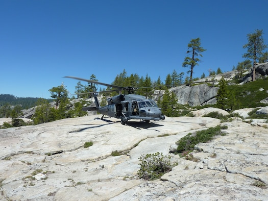 An HH-60G Pave Hawk helicopter from the 129th Rescue Wing lands in El Dorado National Forest, Calif. during a rescue mission on July 4, 2011.  An aircrew from 129th Rescue Wing rescued a lost hiker after she was missing in the forest for nearly 48 hours.  (California Air National Guard photo by Staff Sgt. Andrew Gibson)