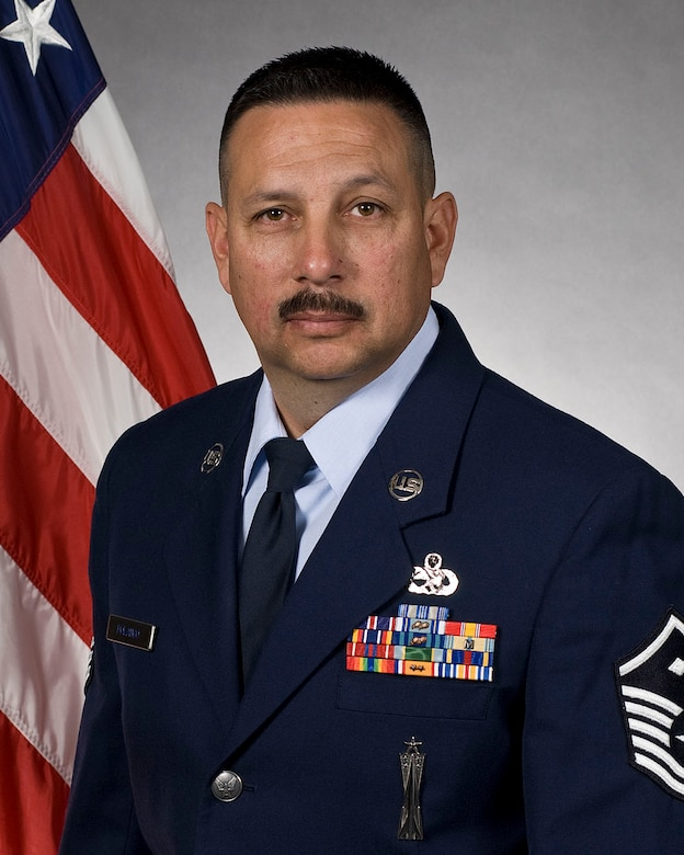 """Master Sgt. Marc Polanco serves as the first sergeant for the 162nd Mission Support Group in addition to his new duties as the wing's maintenance operations center supervisor. """"I'd like to thank my wife and my family for their support. Withouth it, my career in the Guard wouldn't be possible,"""" said Polanco. (U.S. Air Force photo/Master Sgt. Dave Neve)"""