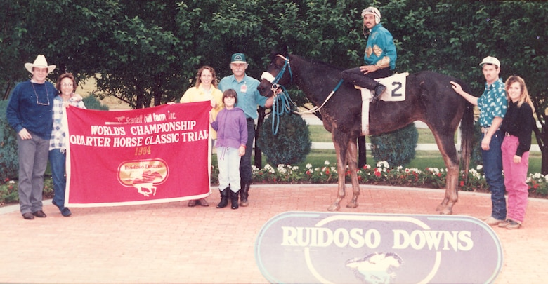 A 117-pound Polanco commemorates his victory with family and friends at the World's Championship Quarter Horse Classic Trials at Ruidoso Downs, New Mexico, July 21, 1994. (Courtesy photo)
