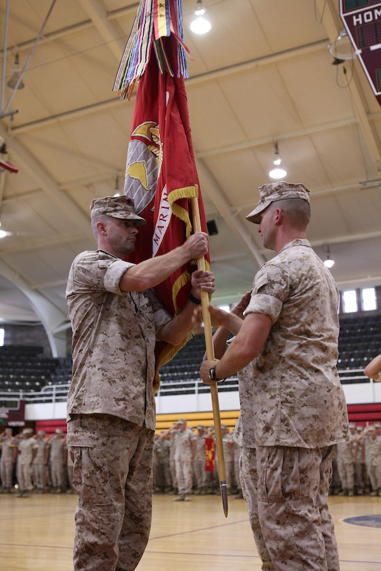 Lieutenant Col. Jeffrey C. Smitherman (right) transfers command of 1st Battalion, 10th Marine Regiment, 2nd Marine Division, to Lt. Col. Robert J. Hallett during a change of command ceremony aboard Marine Corps Base Camp Lejeune July 7, 2011. Smitherman is relinquishing his command after successfully leading 1/10 on their recent deployment to Afghanistan.