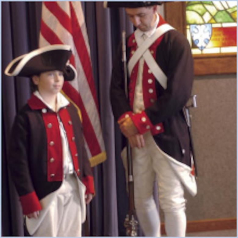 """Asael Horne (left) and Benjamin Horne wear Colonial Army uniforms appropriate to the period at the """"Let Freedom Ring"""" National Bell Ringing ceremony July 4 at the Nate Mazer Memorial Chapel at the Hill Aerospace Museum. (U.S. Air Force photo by Anne Morrison)"""