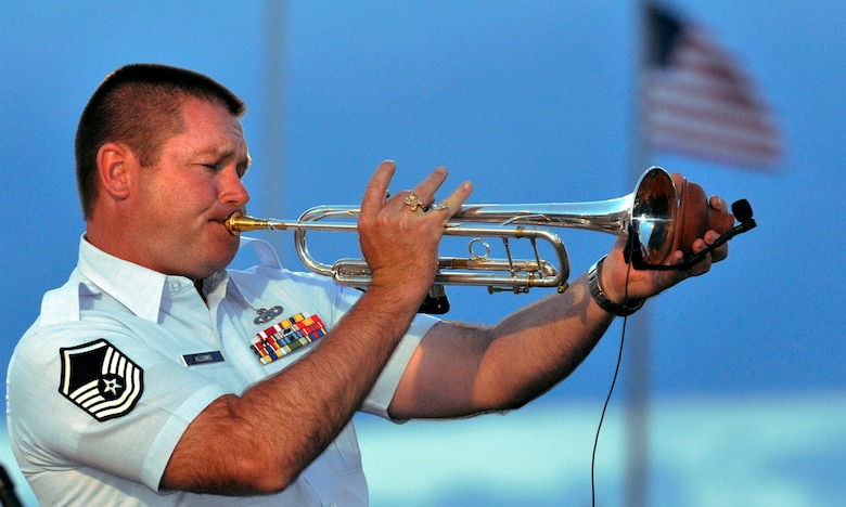 Master Sgt. Tim Allums performs at the Air Force Academy's Independence Day celebration July 4, 2011, at Falcon Stadium in Colorado Springs, Colo. Sergeant Allums is a trumpet player with the Air Force Academy Band and a native of Beaumont, Texas. (U.S. Air Force photo/Megan Davis)
