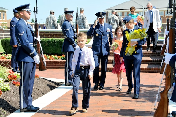 Lt. Col. Kenneth A. Marentette, U.S. Air Force Honor Guard commander and his family depart following the change of command ceremony on the ceremonial lawn, July 12, Joint Base Anacostia-Bolling, D.C. Marentette assumed command  from  Lt. Col. Raymond Powell  The ceremony was hosted by Col. Gina M. Humble, 11th Operations Group commander. (U.S. Air Force photo by Senior Airman Steele C. G. Britton)