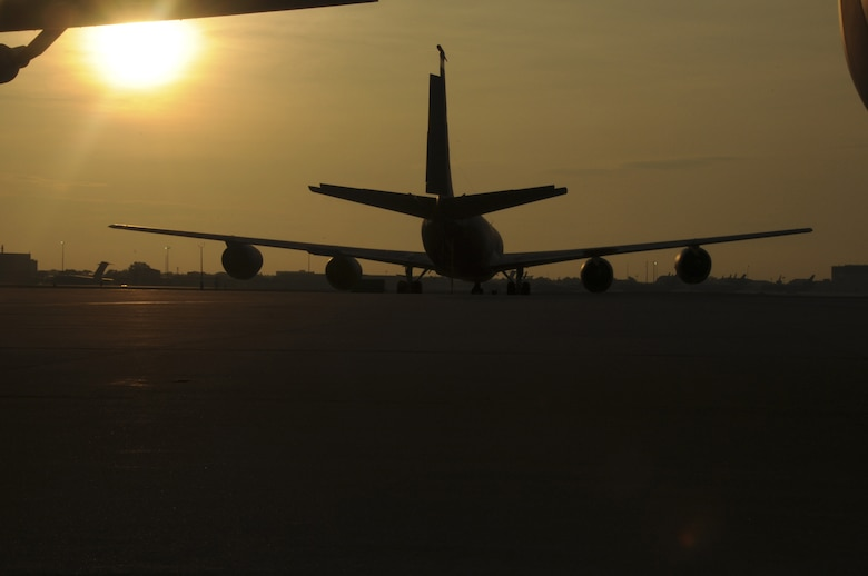 A KC-135R Stratotanker sits at the flight line where approximately 30 members of the 108th Security Forces Squadron prepared to deploy from Joint Base McGuire-Dix-Lakehurst on July 12, 2011. The security forces members deployed to Southwest Asia in support of Operation New Dawn where they will be responsible for maintaining security at the air base. (U.S. Air Force photo/Airman Kellyann Novak)