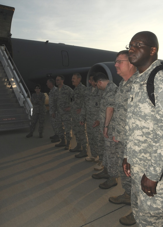 Senior leadership from the 108th Wing and New Jersey Air National Guard line up in front of a KC-135R Stratotanker to say farewell to the approximately 30 members of the 108th Security Forces Squadron deploying from Joint Base McGuire-Dix-Lakehurst on July 12, 2011. The security forces members deployed to Southwest Asia in support of Operation New Dawn where they will be responsible for maintaining security at the air base. (U.S. Air Force photo/Airman Kellyann Novak)