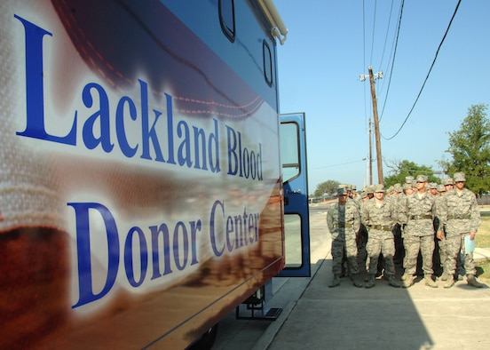Basic military trainees from the 323rd Training Squadron stand at ease in front of the bloodmobile July 6, 2011, at the Blood Donor Center, Lackland Air Force Base, Texas. The center collects about 1,100 units of blood each month and depends on the Lackland BMTs and other donors. More than 60 trainees attended a ribbon-cutting event, unveiling the new vehicle that will be used to conduct blood drives at locations in San Antonio, Texas. (U.S. Air Force photo/Senior Airman Kevin Iinuma)