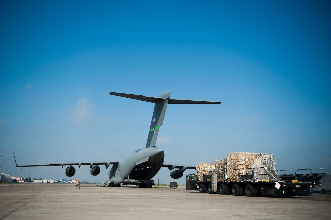 Airmen from the 728th Air Mobility Squadron Aerial Port Flight load cargo onto a C-17 Globemaster III aircraft July 11, 2011, at Incirlik Air Base, Turkey. The aerial port flight is responsible for transportation-related functions including the movement of freight bound for Europe, Africa, and Southwest and Central Asia. (U.S. Air Force photo by Tech. Sgt. Michael B. Keller/Released)