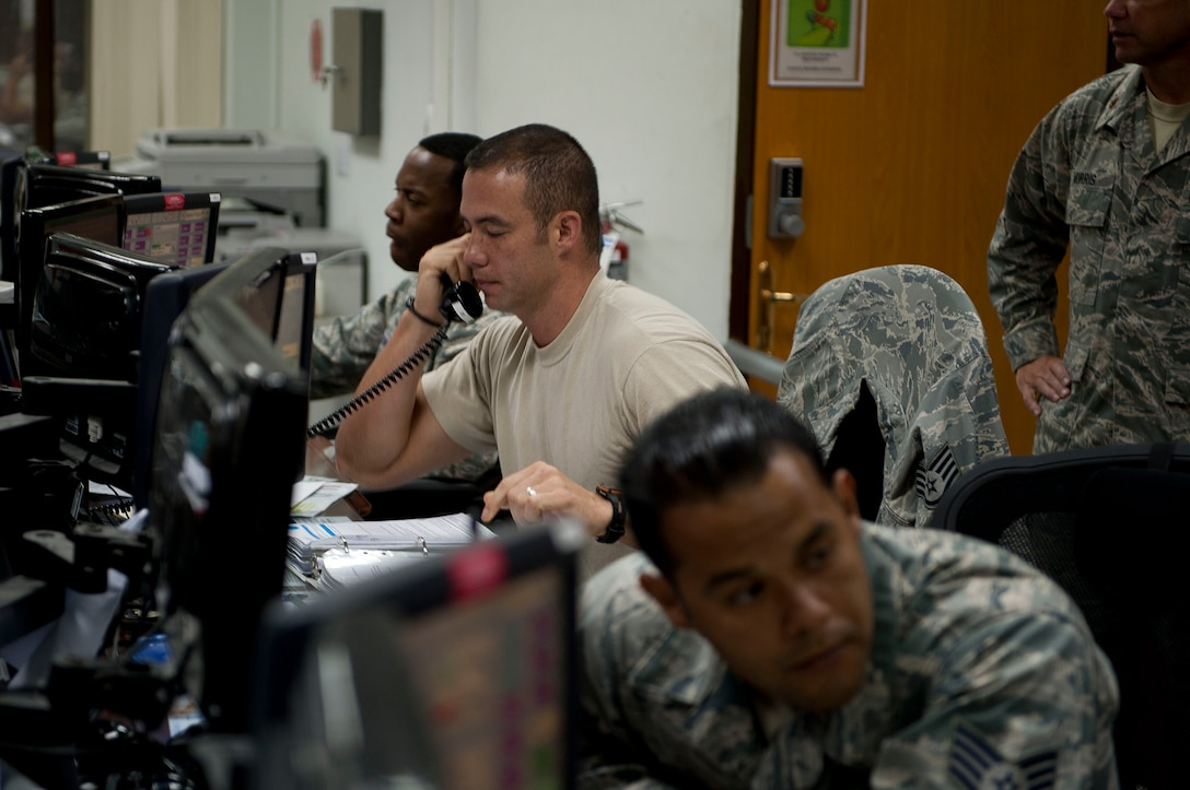 Staff Sgt. David Midyett, 728th Air Mobility Squadron, answers the phone in the air transportation operations center July 11, 2011, at Incirlik Air Base, Turkey. The center directs maintenance operations and airlift support aircraft arrivals and departures. (U.S. Air Force photo by Tech. Sgt. Michael B. Keller/Released)