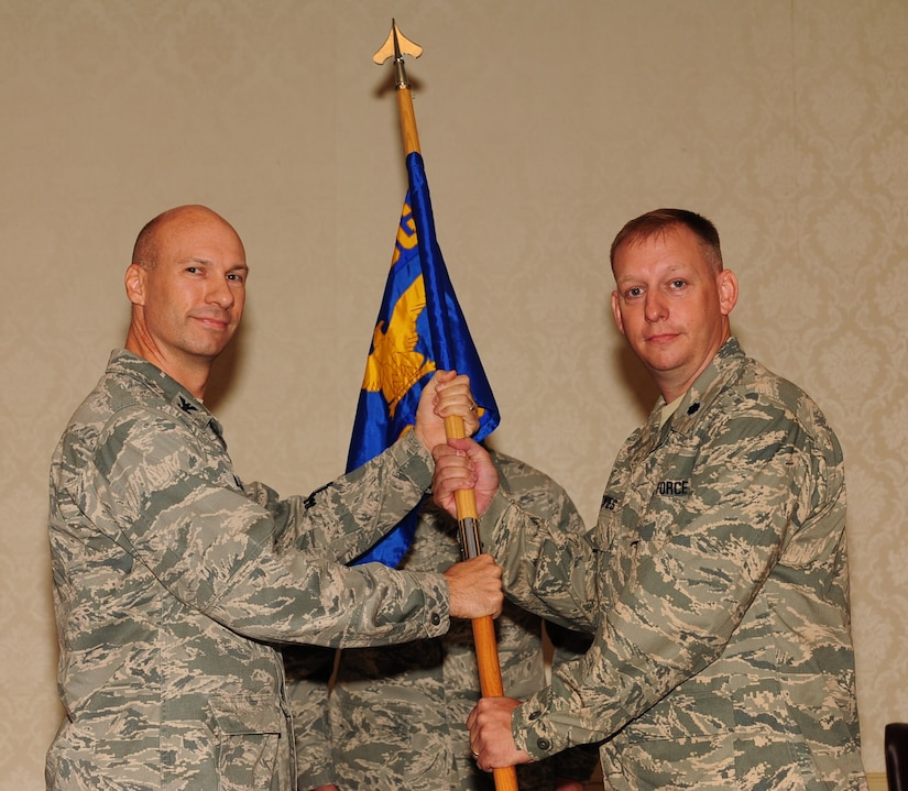 Lt. Col. Aaron Altwies accepts the 628th Civil Engineer Squadron guidon from Col. Justin Davey during the 628 CES Change of Command July 8 at Joint Base Charleston, S.C. Altwies is the new 628 CES commander and Davey is the 628th Mission Support Group commander. (U.S. Air Force photo/Tech. Sgt. Chrissy Best)