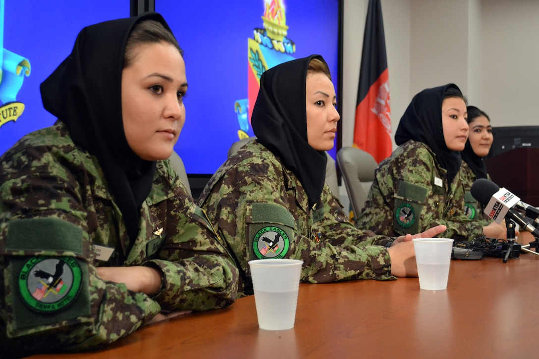 Four Afghan helicopter pilot candidates attend a press conference July 13, 2011, at the Defense Language Institute English Language Center at Lackland Air Force Base, Texas. The women begin their English language studies at the DLIELC, marking a significant milestone in shaping the reconstruction of Afghanistan. (U.S. Air Force photo/Staff Sgt. Desiree N. Palacios)