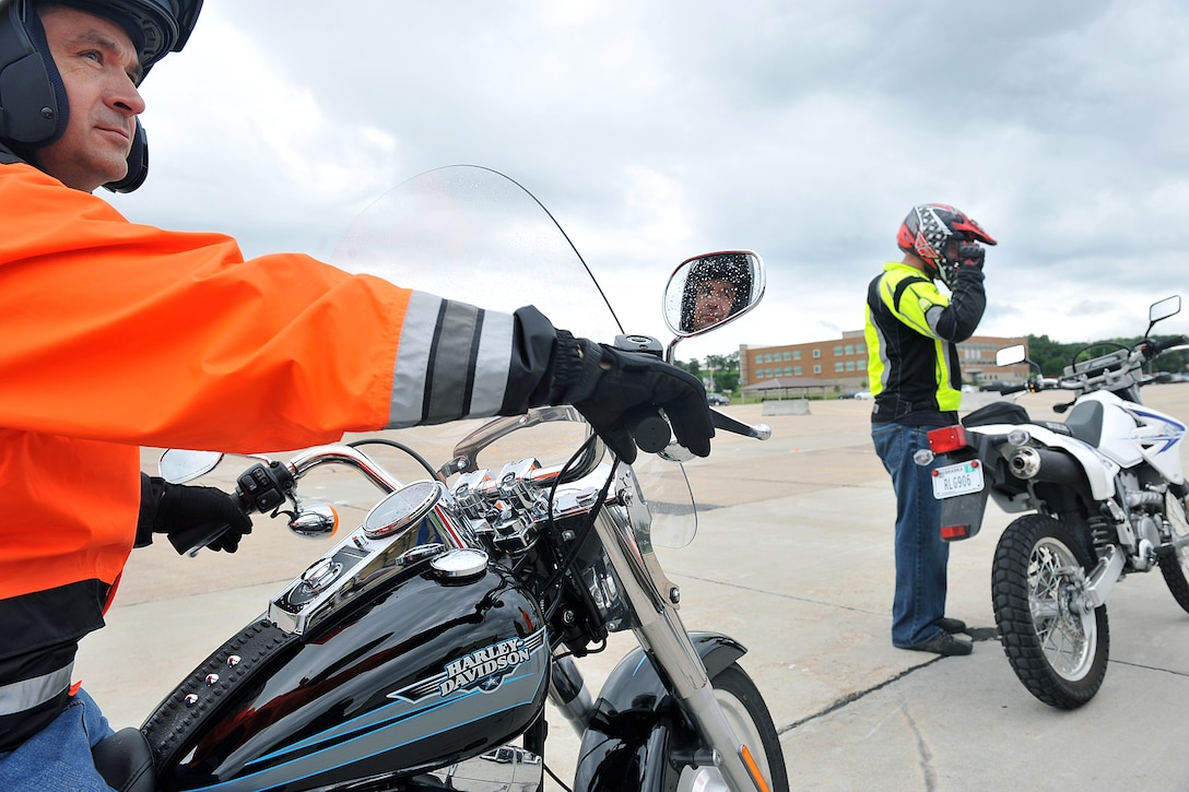 U.S. Air Force Brig. Gen. Donald Bacon, 55th Wing commander, sits on his motorcycle while an instructor teaches the Basic Riders Course 2 motorcycle training class in the Air Force Weather Agency parking lot on Offutt Air Force Base, Neb., on July 7. (U.S. Air Force Photo by Charles Haymond/Released)