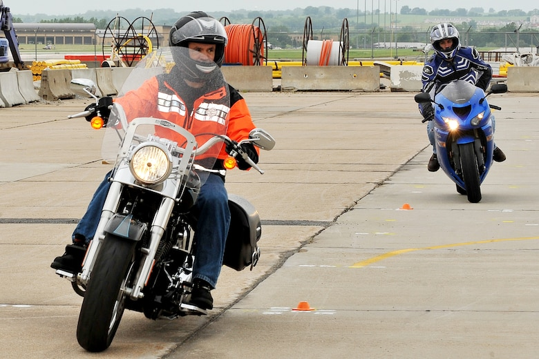 U.S. Air Force Brig. Gen. Donald Bacon, 55th Wing commander, weaves through cones during the Basic Riders Course 2 motorcycle training class in the Air Force Weather Agency parking lot on Offutt Air Force Base, Neb., on July 7. (U.S. Air Force Photo by Charles Haymond/Released)