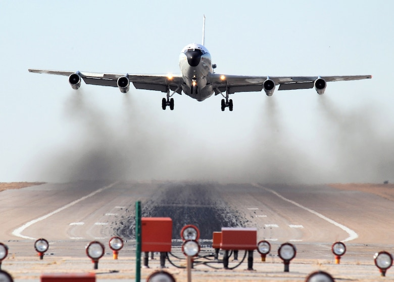"A WC-135 Constant Phoenix aircraft takes off from Offutt Air Force Base, Neb.  The aircraft collects air samples from areas around the world using an on-board atmospheric collection suite.  The collection suite allows the mission crew to detect radioactive ""clouds"" in real time.  (U.S. Air Force photo/Josh Plueger)"