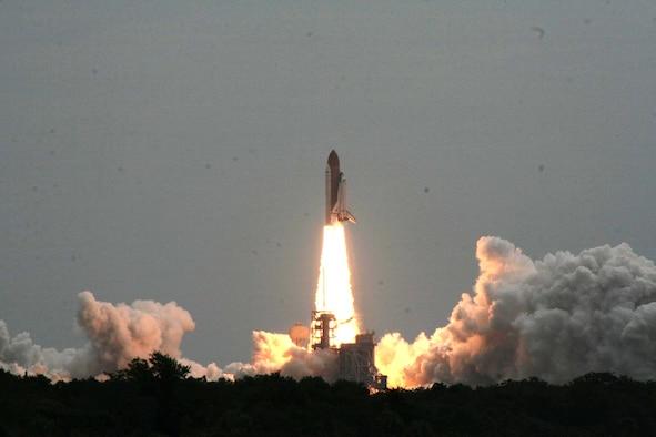 The Space Shuttle Atlantis taks off on its last flight. Photo by Lt. Col. Michael Humphreys.