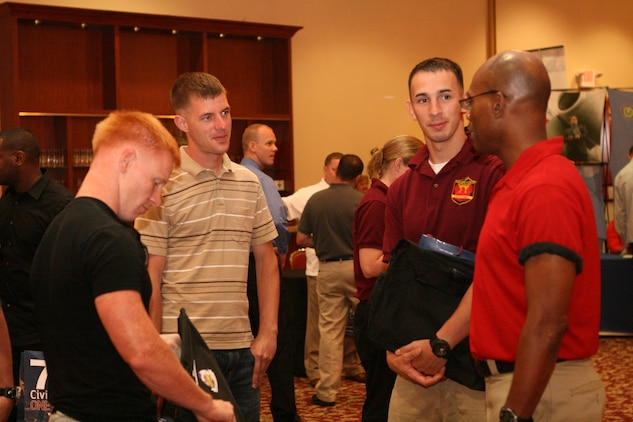 Mr. Gary Simpson the Department of Labor liaison employment coordinator speaks with wounded, ill and injured Marines from the Wounded Warrior Battalion-West during  the Hiring Heroes Career Fair at the South Mesa Staff Noncommissioned Officers' Club aboard Marine Corps Base Camp Pendleton, Calif., July 13.  The Hiring Heroes Career Fair is a part of the Department of Defense's Civilian Personnel Management Service, Recruitment Assistance Division's outreach program that provides specialized transition assistance to wounded, ill and injured service members whose careers have been cut short.