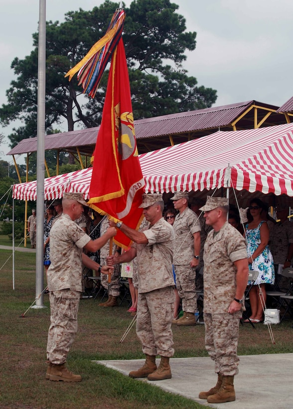 Col. Paul J. Kennedy, the former commanding officer of 2nd Marine Regiment, 2nd Marine Division, faces away from the audience while receiving the guidon from Sgt. Maj. George W. Young Jr., the regimental sergeant major, during a change of command ceremony aboard Marine Corps Base Camp Lejeune, N.C., July 14, 2011. Kennedy relinquished his command to Col. William M. Jurney after leading the regiment for the past three years.