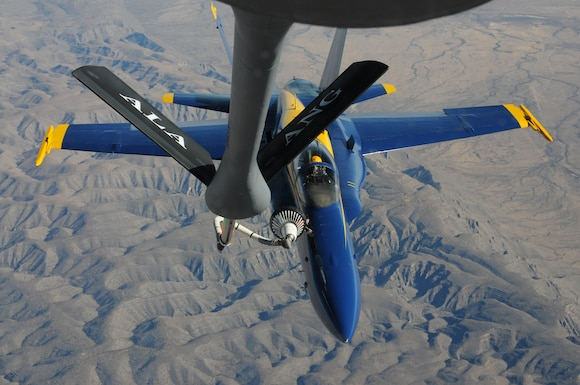 An F/A-18 Hornet aircraft assigned to the U.S. Navy Flight Demonstration Squadron, the Blue Angels, refuels from a KC-135R Stratotanker aircraft in flight over the United States Jan. 3, 2011. The KC-135R is assigned to the 117th Air Refueling Wing, Alabama Air National Guard. (U.S. Air Force photo by Master Sgt. Ken Johnson/Released)