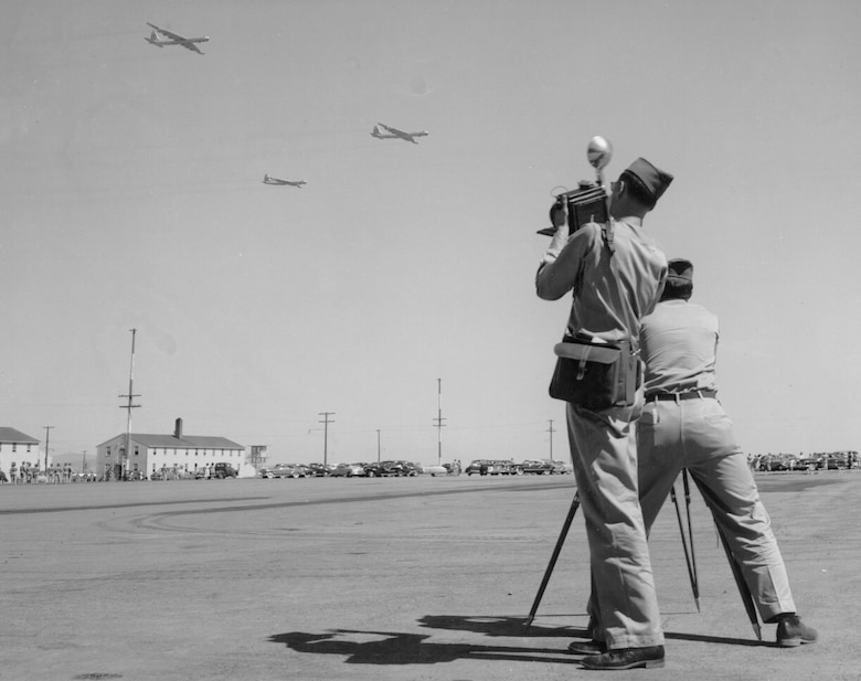 Base photographers focus in on B-36s performing a flyover during the dedication ceremony July 20, 1951. (Historical photo)