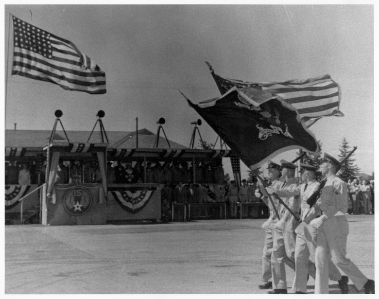 : The color guard performs a Pass in Review for the distinguished guests at the dedication ceremony July 20, 1951. (Historical photo)