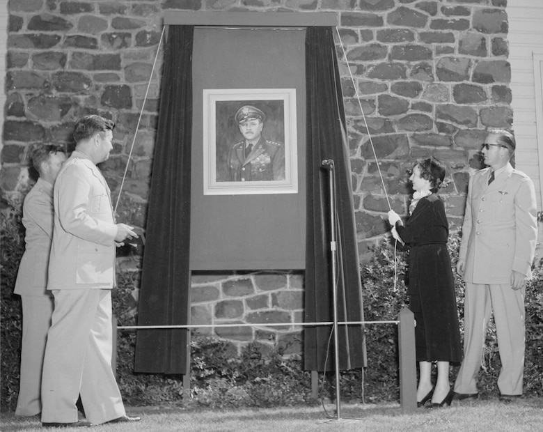 Gen. C. J. Bondley Jr., 57th Air Division Commander,  Lt. Gen. Curtis E. LeMay,  Mrs. Fairchild, Lt. McGanoy, Assistant Club Officer unveil a portrait of Gen. Muir S. Fairchild, Vice Chief of Staff of the Air Force. Fairchild Air Force Base was named after Gen. Fairchild. (Historical photo)