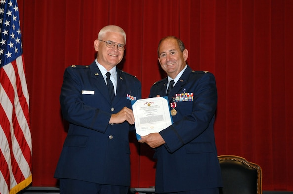 Chaplain (Col.) William Willis, AFRC Command Chaplain, presents the Air Force Meritorious Service Medal to Chaplain (Col.) Raymond L. Hagan, 4th Air Force Senior Staff Chaplain, during Hagan's retirement ceremony at March Air Reserve Base, Calif., July 9, 2011.  Hagan retired after more than 24 years of service as a chaplain in the U.S. Air Force.  (U.S. Air Force photo/Staff Sgt. Sean Adams)
